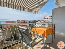 balcony with table, chairs and sunshade - with view of the islands Brac and Hvar